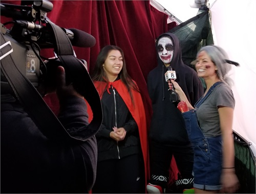 Jenny interviewing two actors for a live segment