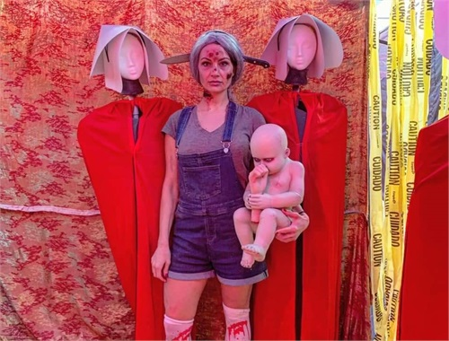 Jenny's photo op in the Handmaid's Tale room
