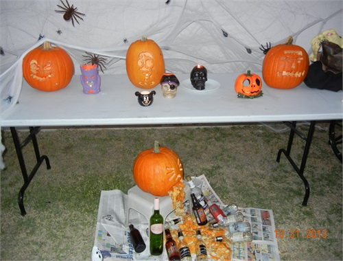 Final pumpkin display with our favorite Pumpkin kickin' it below