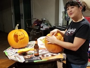 CEO carving the Notorious Drunk Pumpkin
