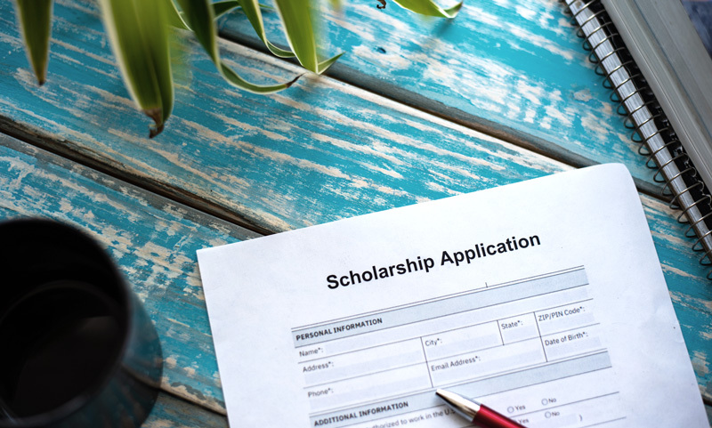 scholarship application on a desk