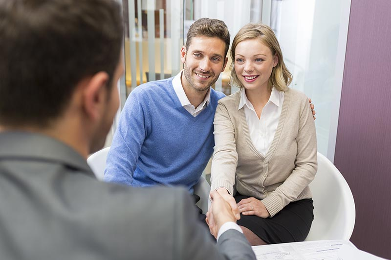 A financial advisor helping two people in Fairfax County, VA