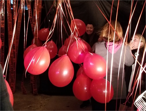 "Blowing up balloons for the ""IT"" room"