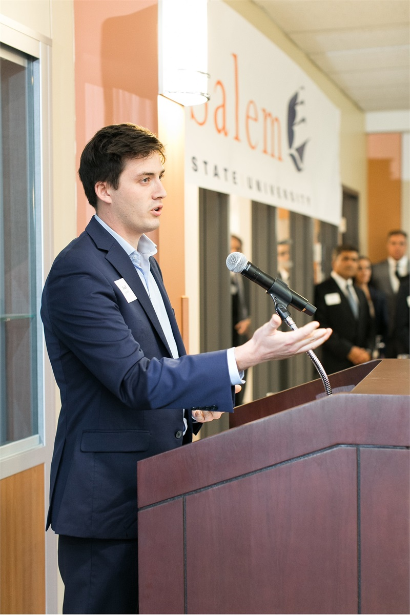 Joel Surrette, research intern at Cabot Wealth Management at podium speaking at Lab Dedication at Salem State University
