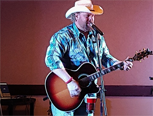 Mike Sugg, America's premiere Toby Keith tribute artist, entertains Winterfest attendees.