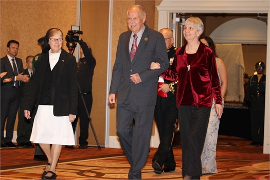 Jim accompanied by his lovely wife, Arlene, receiving the Most Outstanding Alumni award from St. Catherine's Academy.
