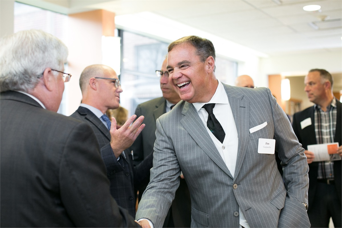 Cabot Wealth Management employee Jim Gasparello shaking hands with attendee at Lab Dedication at SSU.