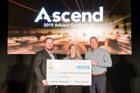 Mark Shoenbeck, EVP, National Sales Director at Kestra Financial, presents T. Eric Reich, President of Reich Asset Management, and Amy Mahon, Director of Operations & Marketing of Reich Asset Management, with a $5,000 check for Big Brothers Big Sisters of Atlantic & Cape May Counties for the 2019 Ascend Award for Community Service.