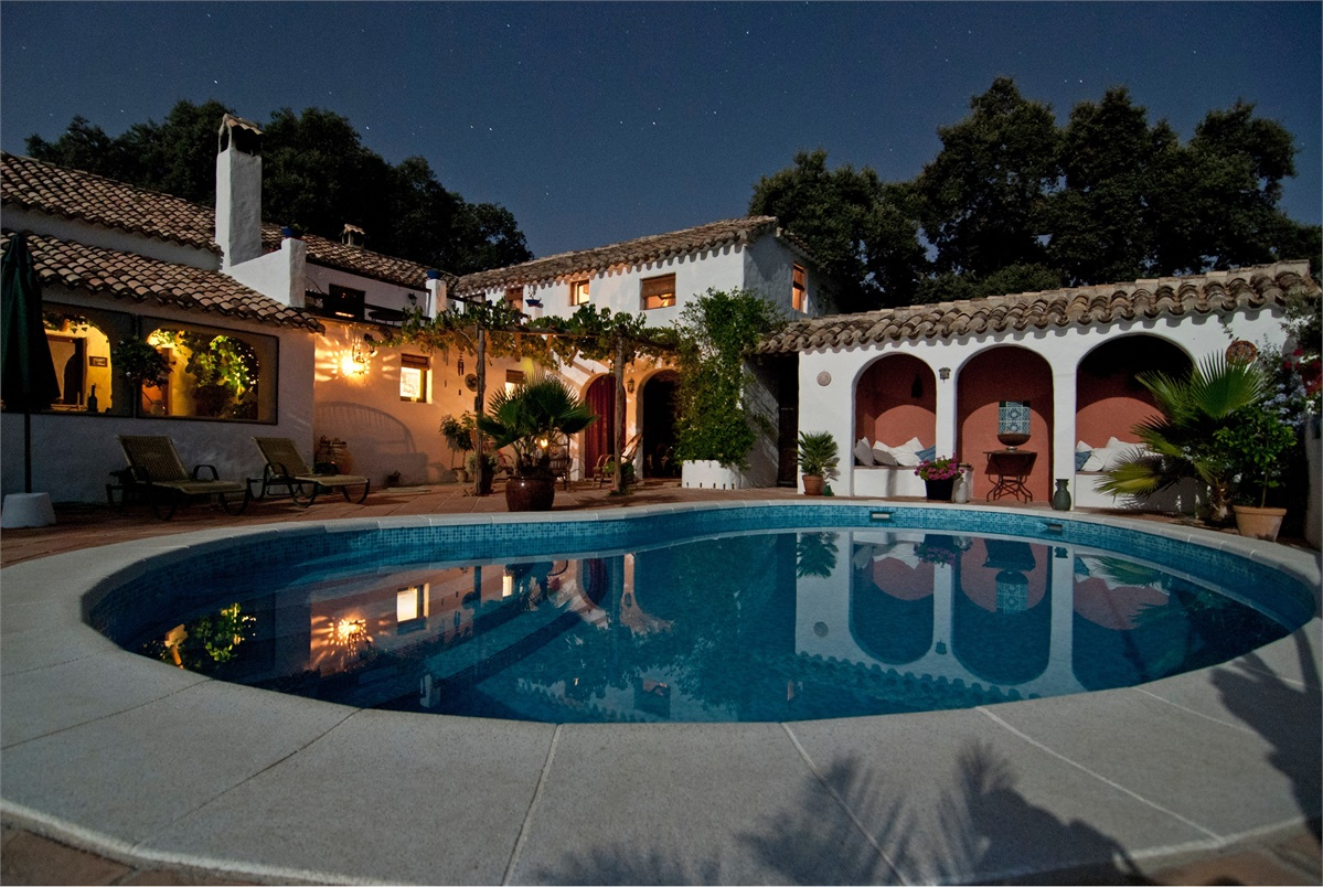Mediterranean villa with pool and an early evening sky