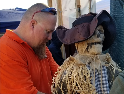 COO turning on the scarecrow in the maze