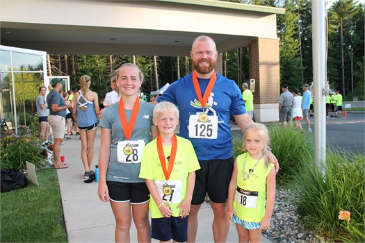Levi and three of his children ran in the 2019 RunStrong 5k