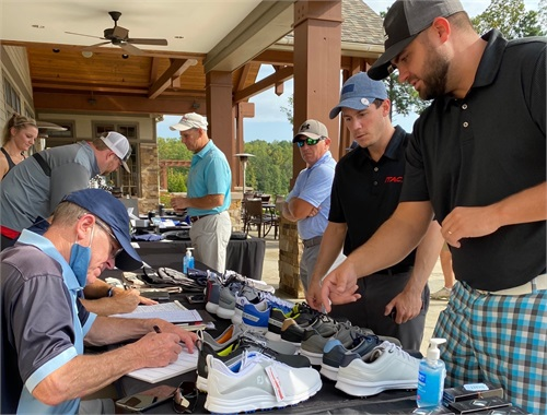 Golfers choosing merchandise from FootJoy®